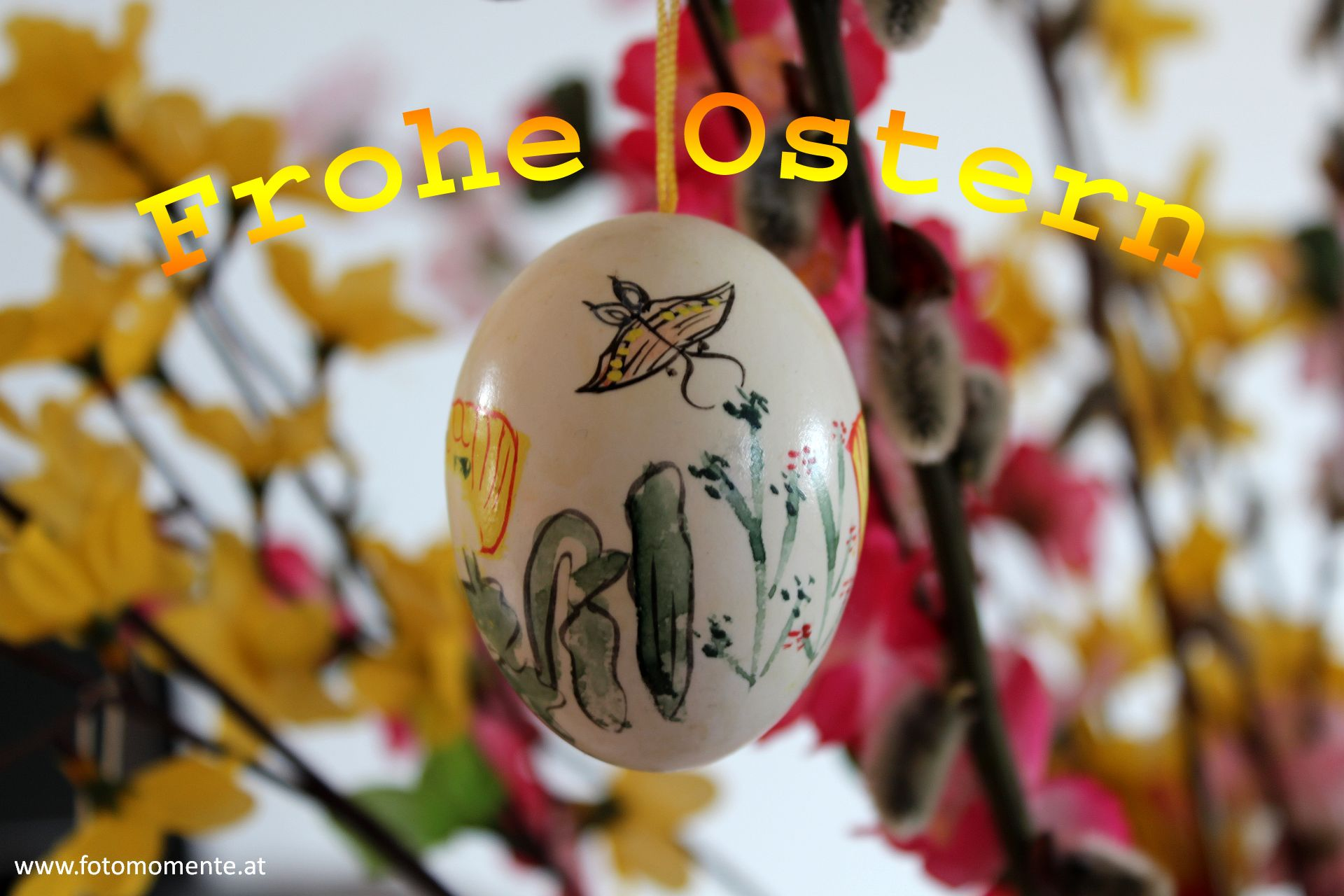 bemaltes osterei auf palmkaetzchenstrauch Ostern2014 - Frohe Ostern